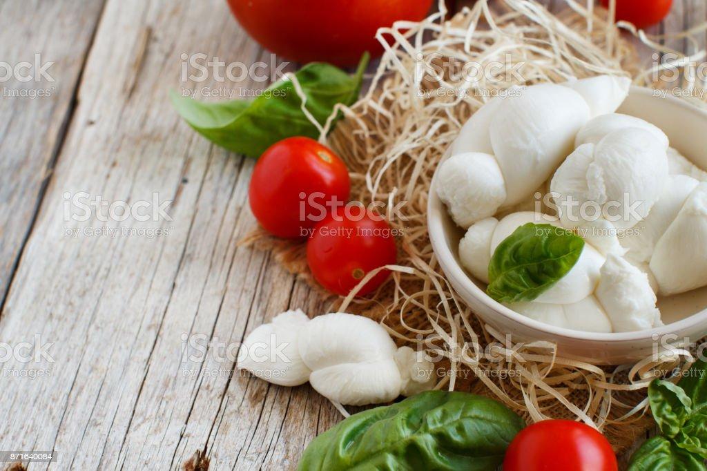 Italian cheese mozzarella nodini with tomatoes and herbs stock photo