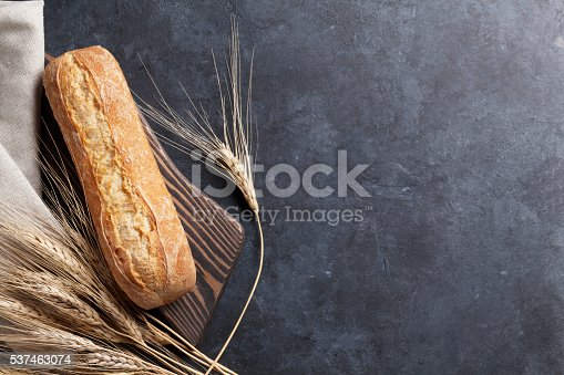 Italian ciabatta bread over stone table. Top view with copy space