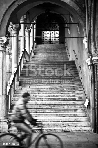 812812808istockphoto Italian City Steps with Person Riding Bicycle, Black and White 108223516