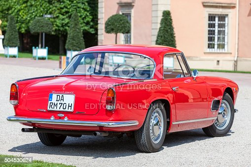 Schwetzingen, Germany - August 29, 2014: A legendary Maserati 3500 GT, red, sports, classic car in excellent condition at a vintage car meeting. This model was produced from 1957-1964.