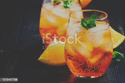 istock Italian cocktail with aperitif, ice and orange, selective focus and toned image 1015447758
