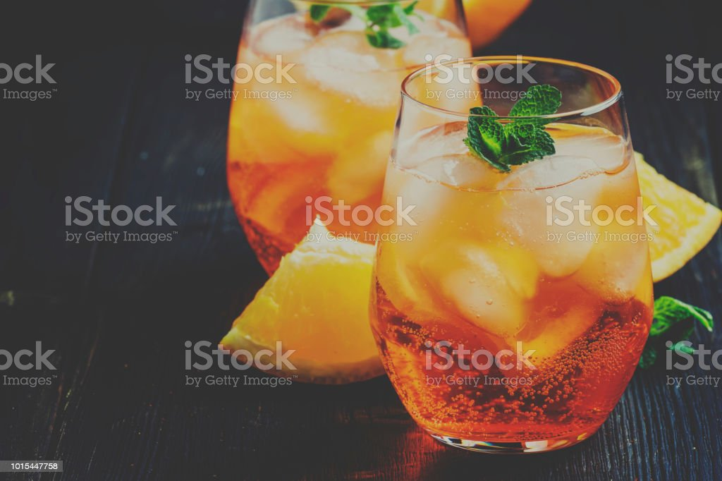 Italian cocktail with aperitif, ice and orange, selective focus and toned image stock photo