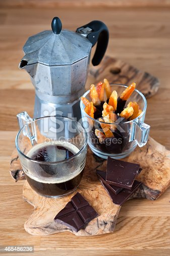 Coffee, candied orange peel with chocolate for a perfect Italian coffee break