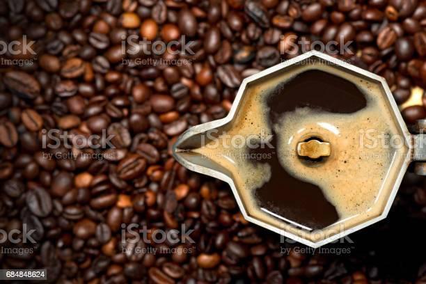 Italian coffee maker with coffee beans picture id684848624?b=1&k=6&m=684848624&s=612x612&h=wqrcvigtunzdvz0qdmalfny6n qxxkeriqf6p zklgm=