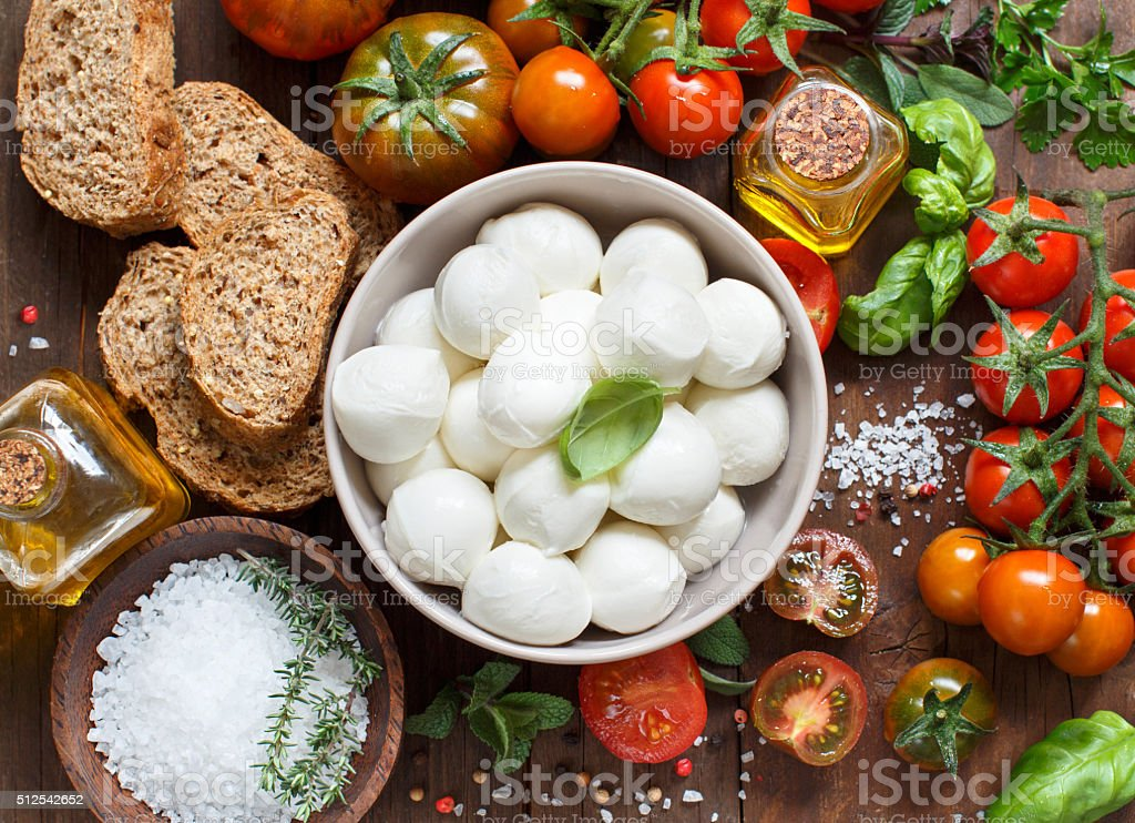 Italian cooking ingridients and mozzarella stock photo