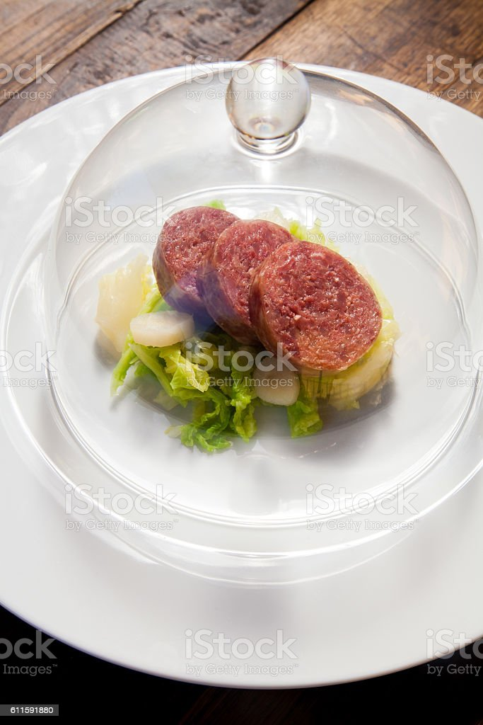 Italian cotechino in a dish stock photo