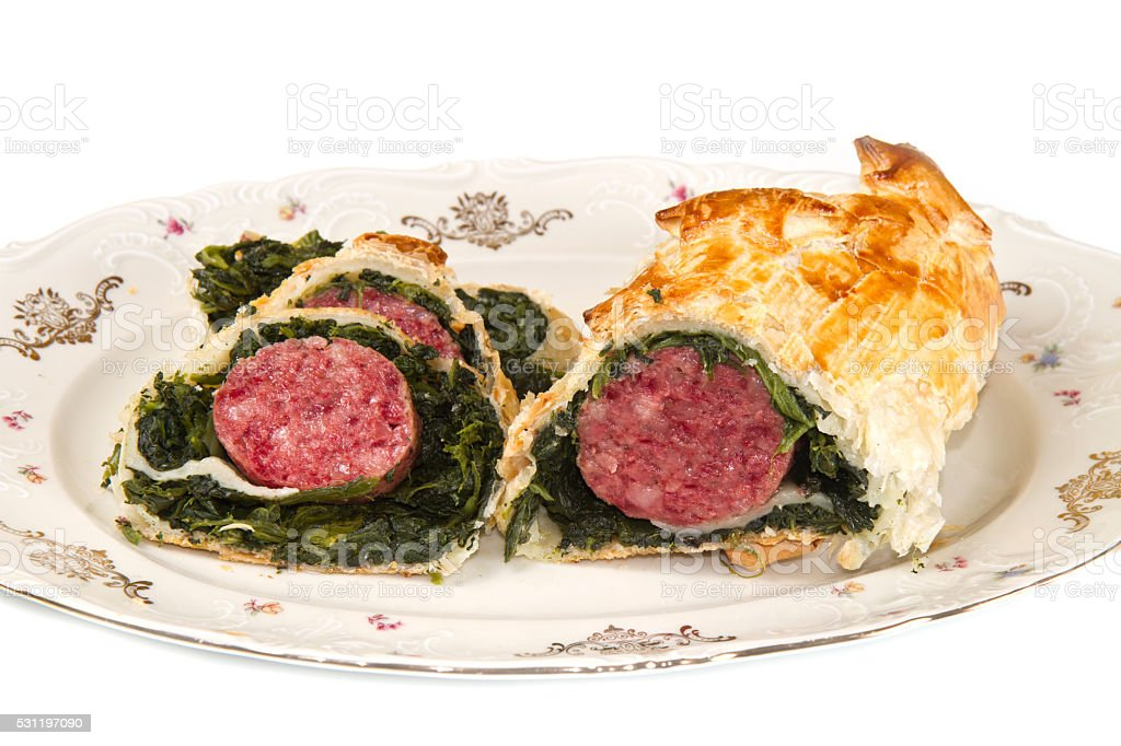 italian cotechino in crust with spinach stock photo