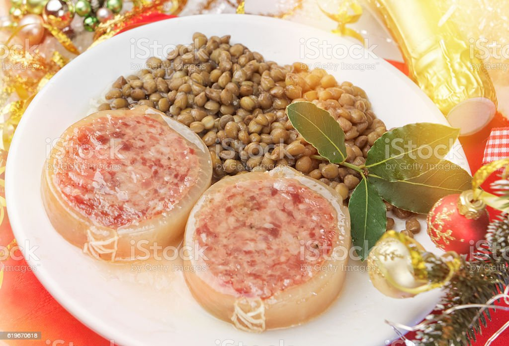 Italian cotechino with lentils closeup stock photo