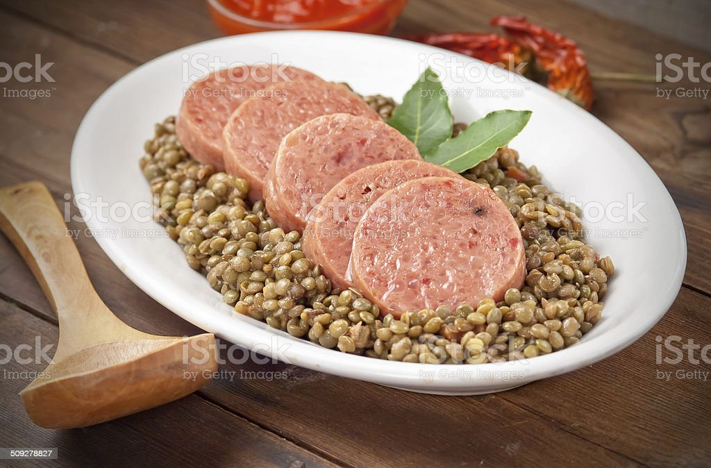 Italian cotechino with lentils stock photo