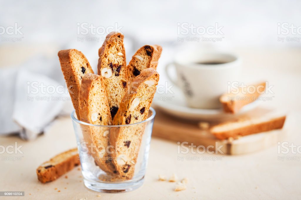 Italian cranberry almond biscotti  and cup of coffee stock photo