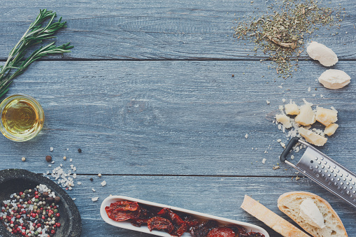 Italian cuisine ingredients background on blue rustic wood, copy space