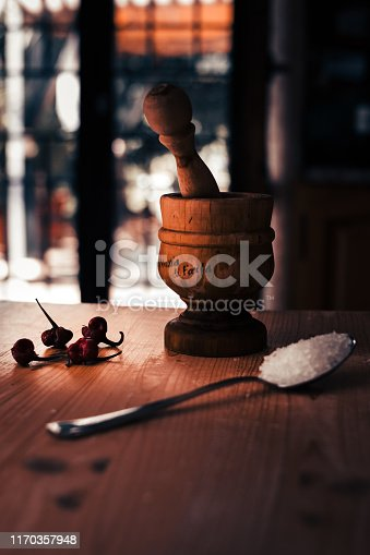 This is the preparation that takes places in an Italian kitchen, An image in warm colors that represents the atmosphere and the happiness of the preparation of Italian dishes
