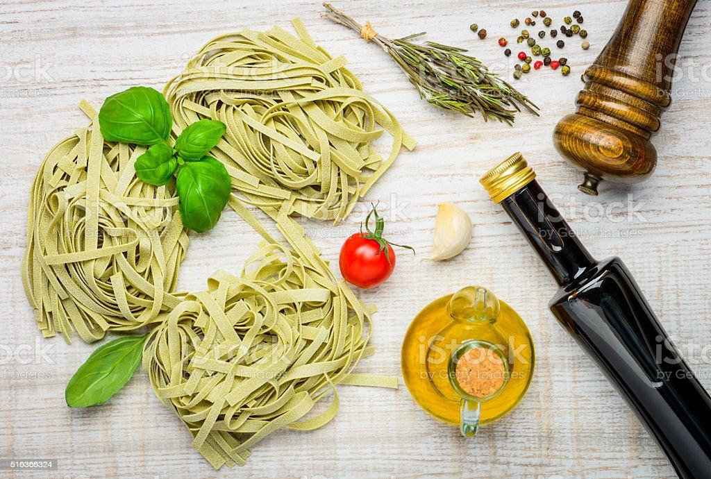 Italian Cuisine Tagliatelle Pasta and Ingredients stock photo