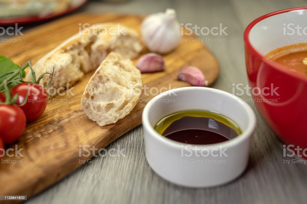 Italian cuisine with olive oil, basil and rustic bread stock photo