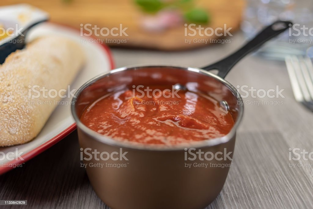 Italian cuisine with tomatoe passata, olive oil, basil and rustic bread stock photo