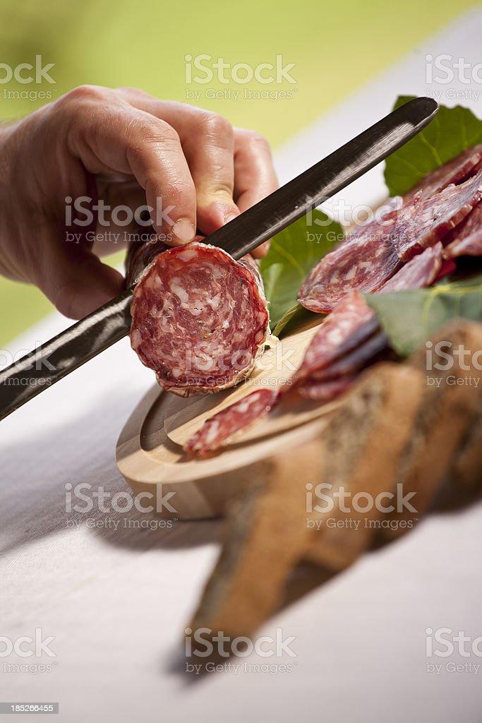 Italian Culture Cutting Salami royalty-free stock photo