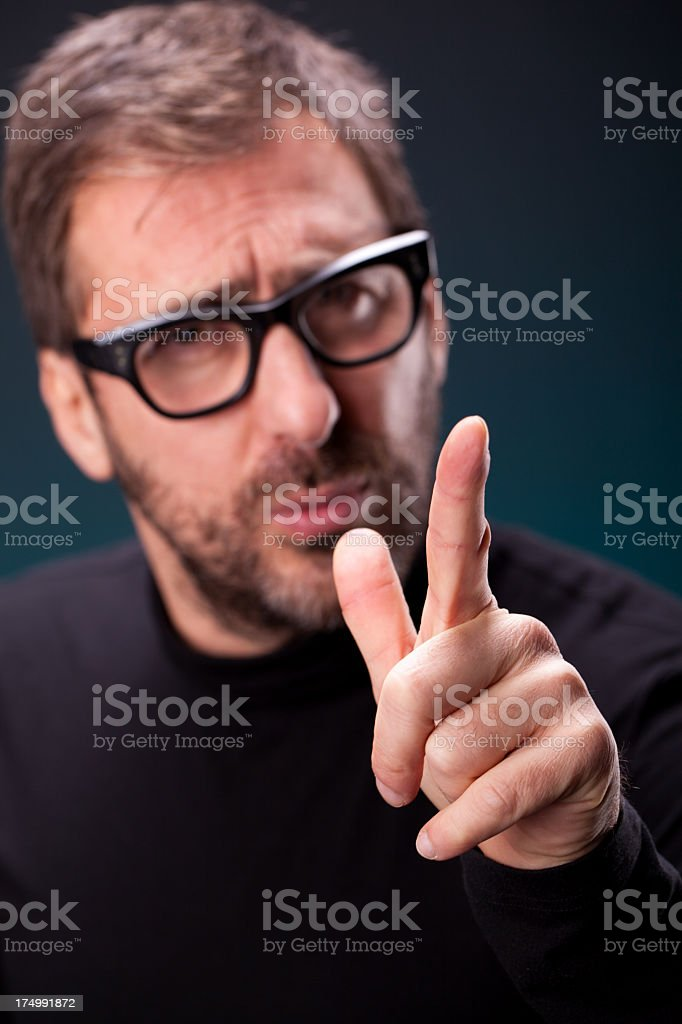 Italian Designer with Retro Eyeglasses Discussing a Concept stock photo