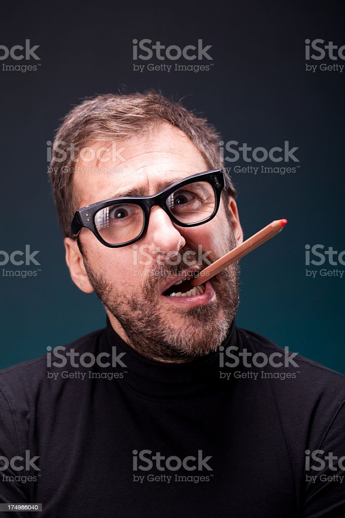 Italian Designer with Retro Eyeglasses Making a Creative Expression stock photo