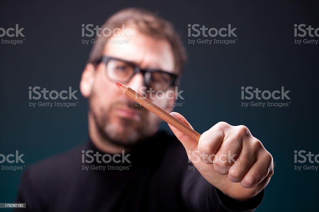 Italian Designer with Retro Eyeglasses Making a Diagonal Measurement stock photo