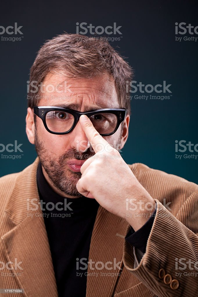 Italian Designer with Retro Eyeglasses Making a Geeky Expression stock photo