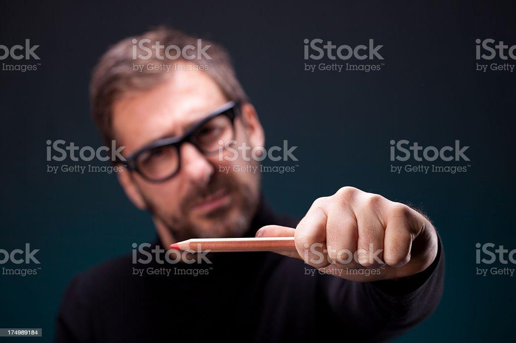 Italian Designer with Retro Eyeglasses Making a Horizontal Measurement stock photo