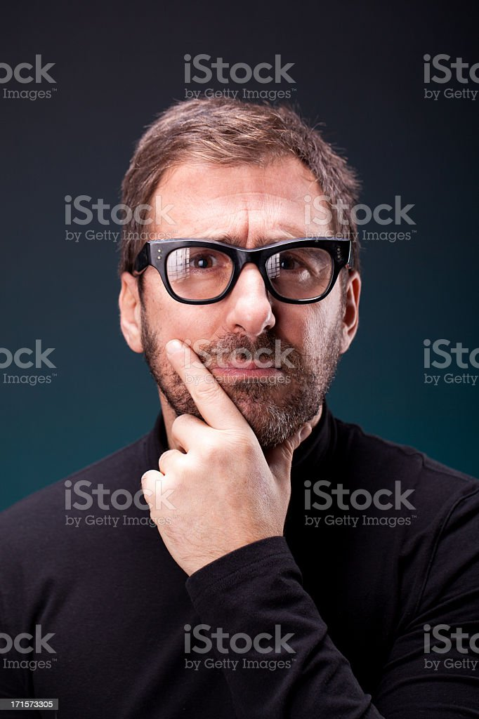 Italian Designer with Retro Eyeglasses Making a Serious Expression stock photo