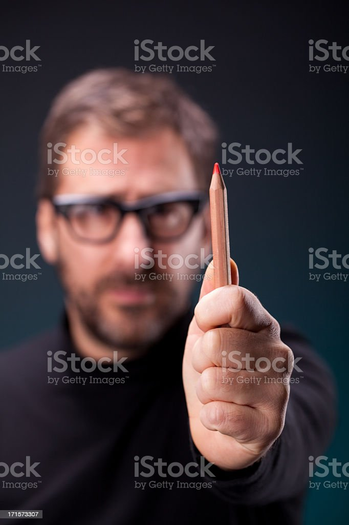 Italian Designer with Retro Eyeglasses Making a Vertical Measurement stock photo