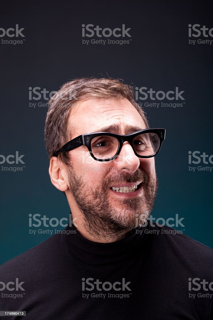 Italian Designer with Retro Eyeglasses Making a Weird Expression stock photo
