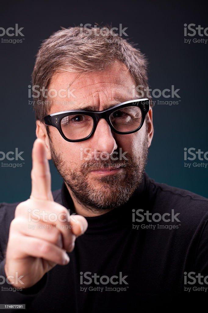 Italian Designer with Retro Eyeglasses Pointing his Finger stock photo