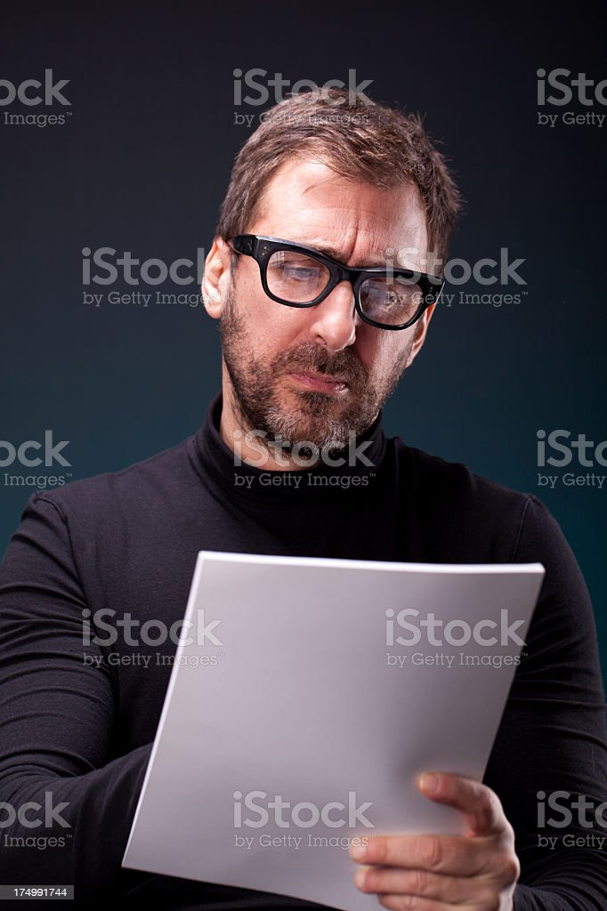 Italian Designer with Retro Eyeglasses Taking a Note stock photo
