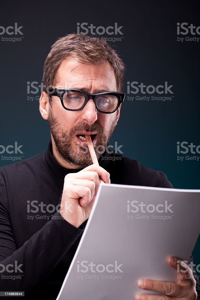 Italian Designer with Retro Eyeglasses Wondering in front of Sketchpad stock photo
