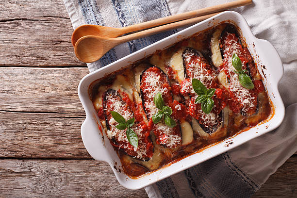 italian eggplant baked with mozzarella in tomato sauce - parmesan stock photos and pictures