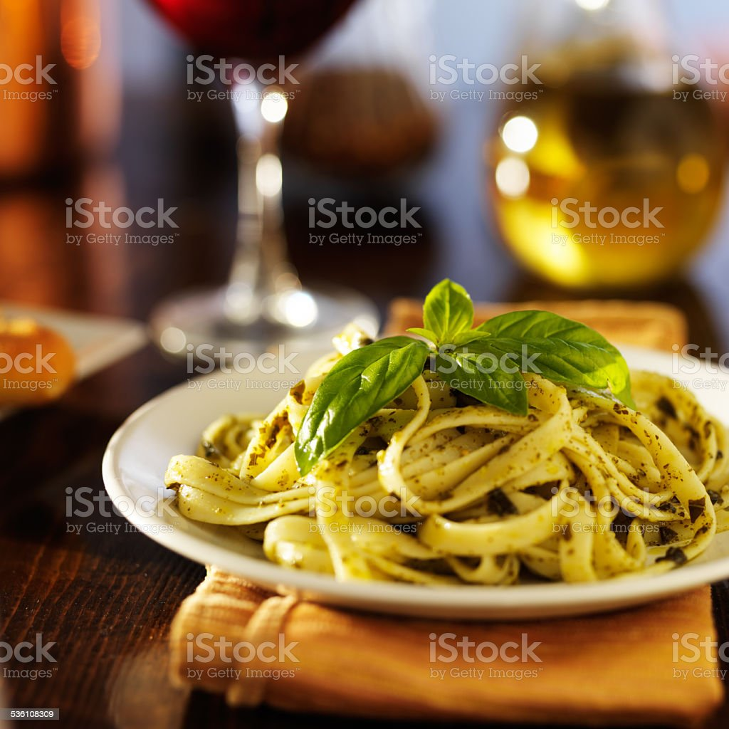 italian fettuccine in basil pesto stock photo