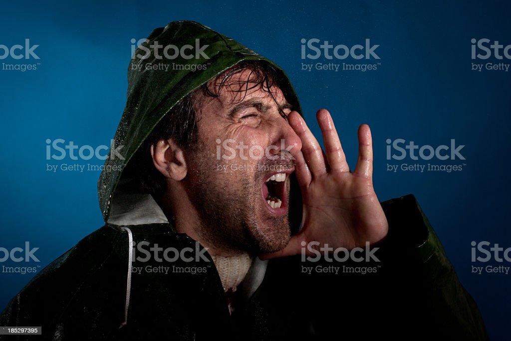 Italiano pescatore urla sotto la pioggia - foto stock