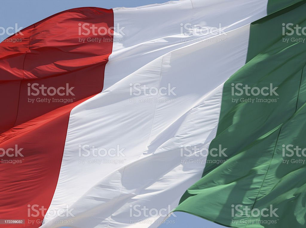 Italian flag  in sun and wind, Italy royalty-free stock photo