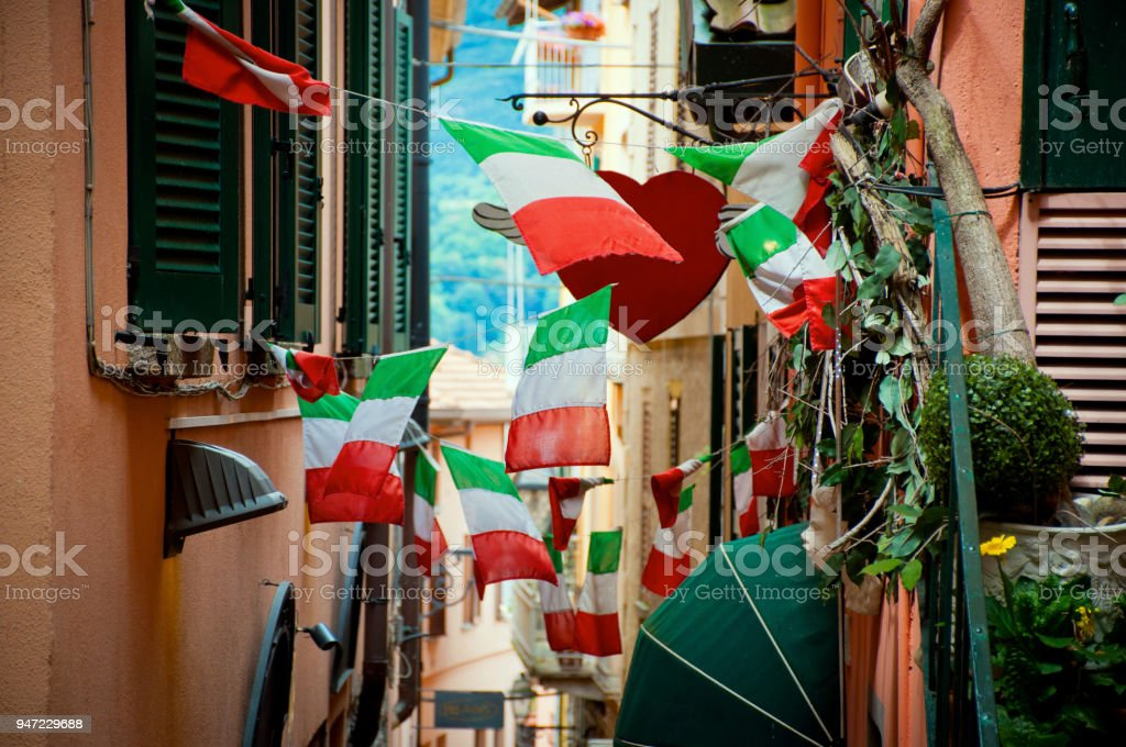 Italian flags on small street narrow street scene filled with italian flags on both sides. City Stock Photo