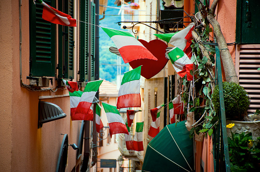 Italian Flags On Small Street Stock Photo - Download Image Now