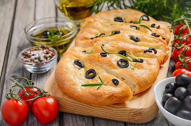 Italian focaccia bread with olives and rosemary stock photo