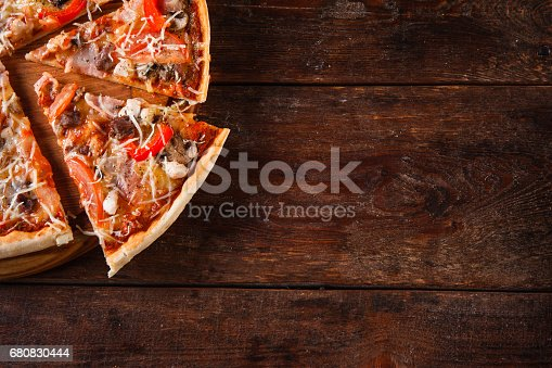 istock Italian food background. Appetizing pizza slices. 680830444