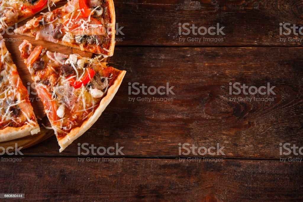 Italian food background. Appetizing pizza slices. stock photo