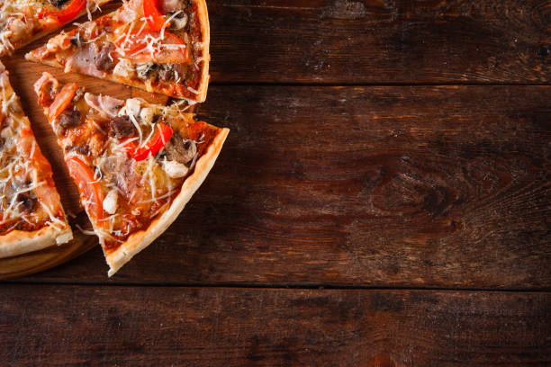 italian food background. appetizing pizza slices. - pizzeria stock photos and pictures