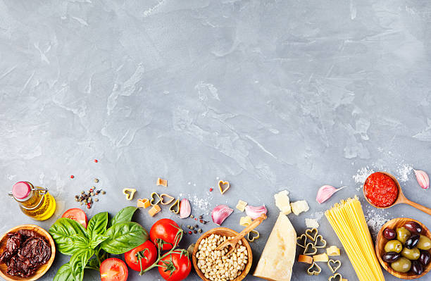 italian food background on stone table copy space top view - food and drink stock photos and pictures