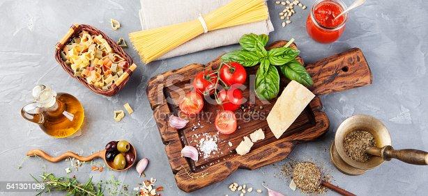 istock Italian food background Tomatoes, basil, spaghetti, parmesan, olive oil, garlic 541301096