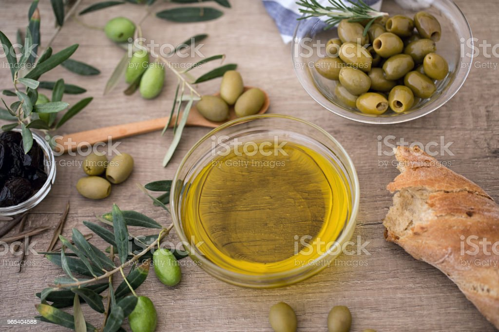 Italian food background with ciabatta bread, olive oil and olives royalty-free stock photo