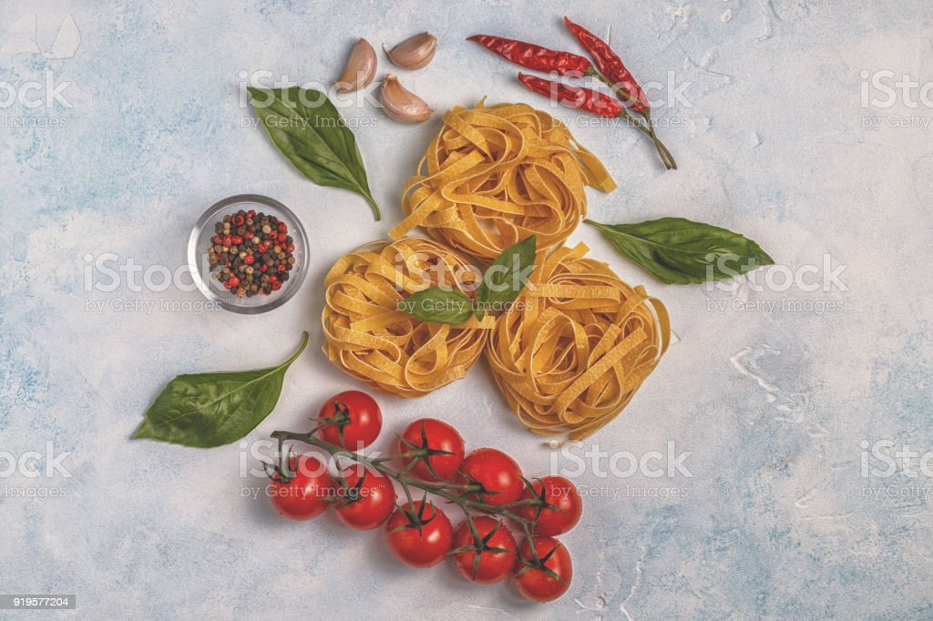 Italian food background with pasta, spices and vegetables. stock photo