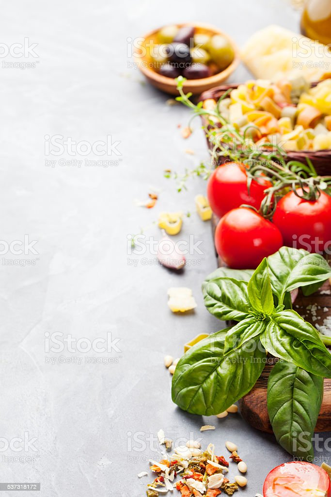 Italian food background with tomatoes, basil, spaghetti, parmesan, olive oil stock photo