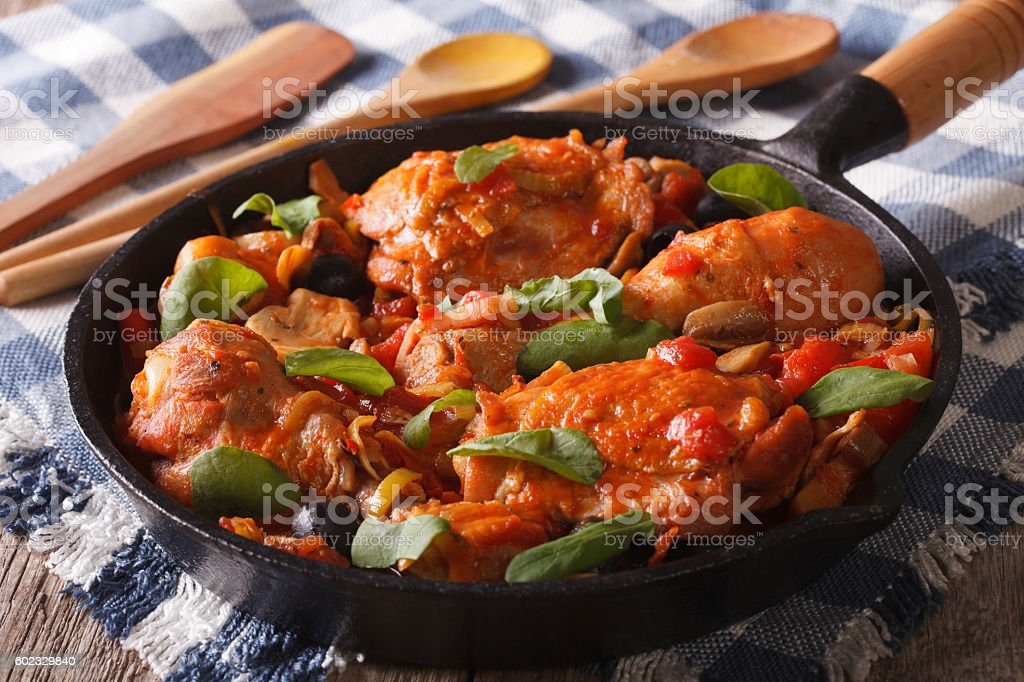 Italian food: chicken with tomato and vegetables. horizontal stock photo