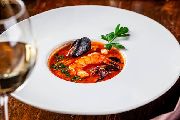 Italian food concept. European Chiopino tomato soup with seafood, with squid, octopus, mussels. Serving dishes in an Italian restaurant. background image. copy space