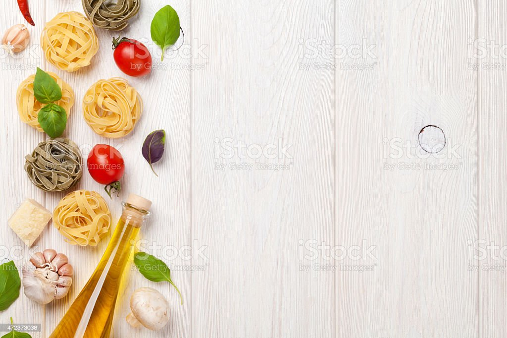 Italian food cooking ingredients. Pasta, tomatoes, basil. Top view...