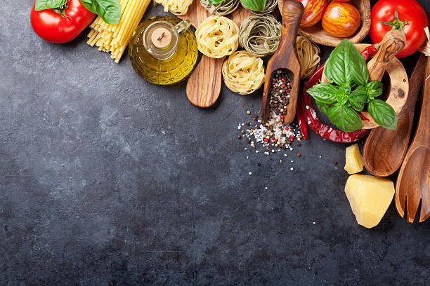 italian food cooking - italian food stock photos and pictures